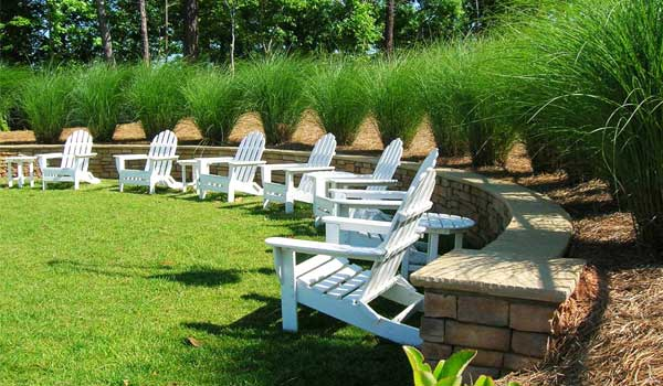 lawn chairs surrounded by a brick fence