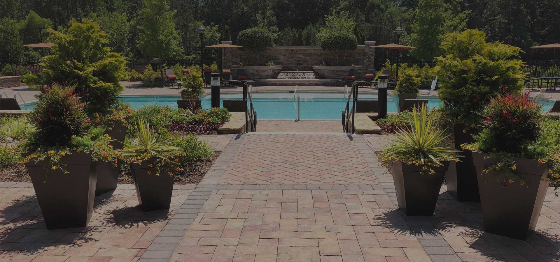 brick path leading to a pool